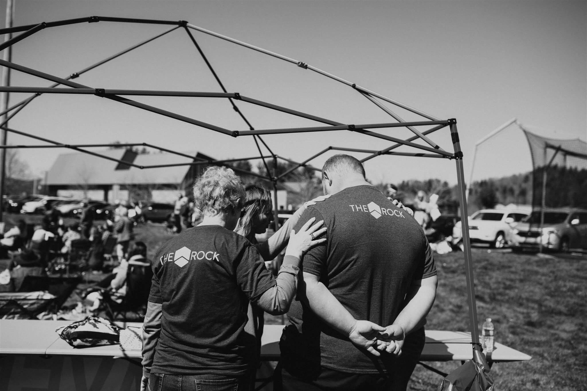 people praying black and white